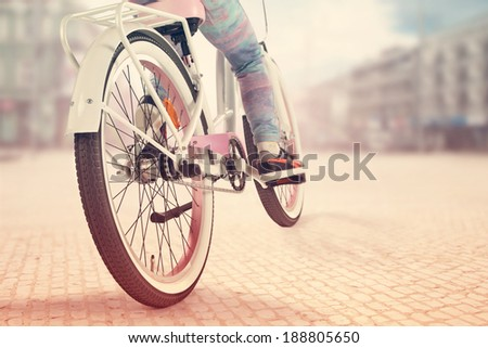 bike in city and girl  - stock photo