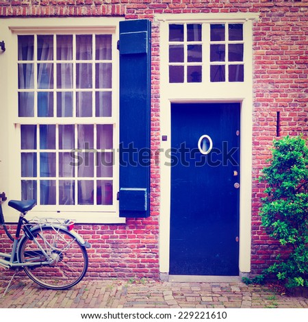 Bike in Front of a Brick Facade of the Old Dutch House, Instagram Effect - stock photo