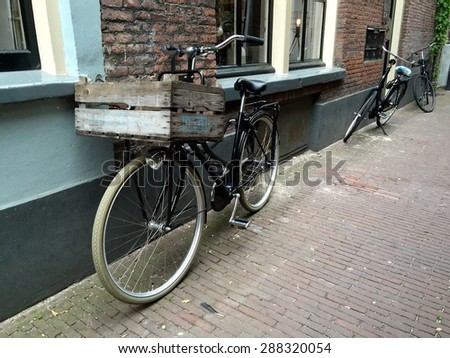 Bike in old street - stock photo