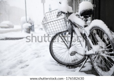Bike in the snow at New York city with copy space - stock photo