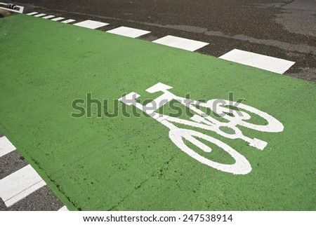 Bike lane sign painted on a street. - stock photo