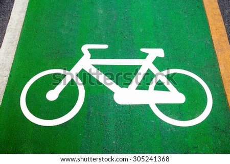 Bike lane signs painted onto a green bike lane ( Bike lane, road for bicycles ) - stock photo