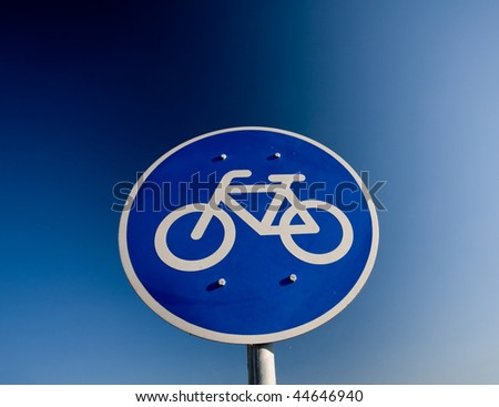 Bike lane traffic sign over blue sky - stock photo
