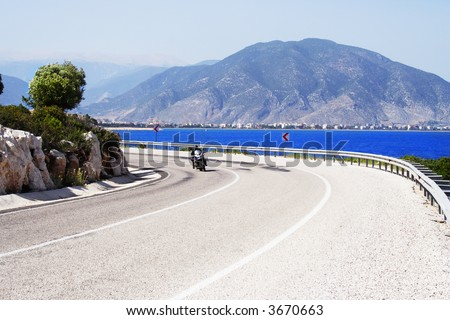 bike on a sunny coastline road - stock photo