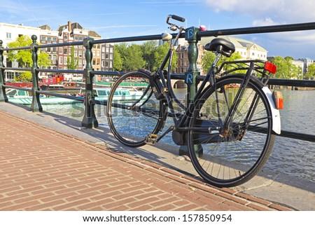 Bike on the bridge in Amsterdam the Netherlands - stock photo
