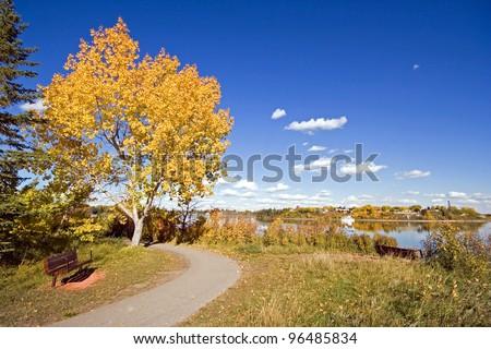 Bike Path around Glenmore Reservoir, Calgary, Alberta, Canada Heritage Park can be seen across the Reservoir - stock photo