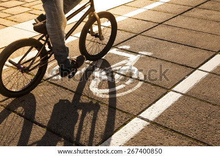 Bike path with a symbol of bike. Biker. - stock photo