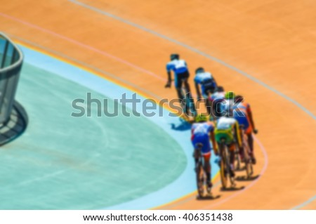 Bike race on velodrome track blurry for background - stock photo
