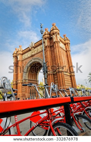 Bike rental Arc de Triomphe in the center of Barcelona, to move into ecologically and environmentally - stock photo