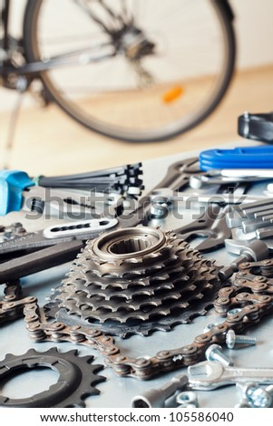 Bike repairing. Spare parts and tools. - stock photo