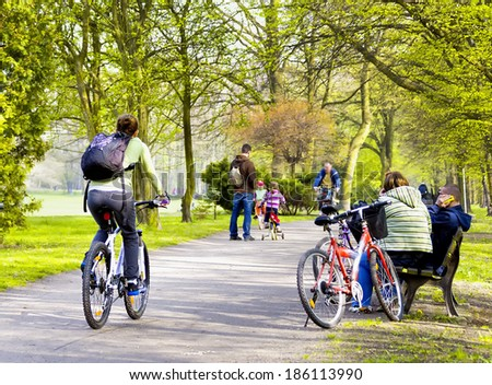 Bike riders in spring park - stock photo