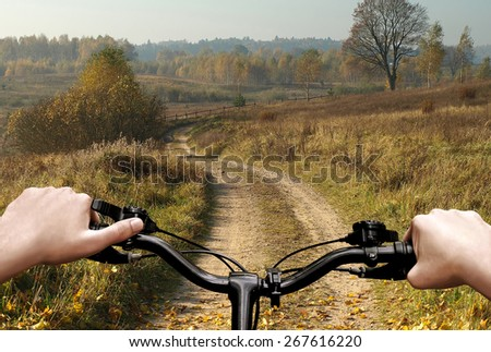 Bike riding on a dirt road. The view from the driver's side. First person view.