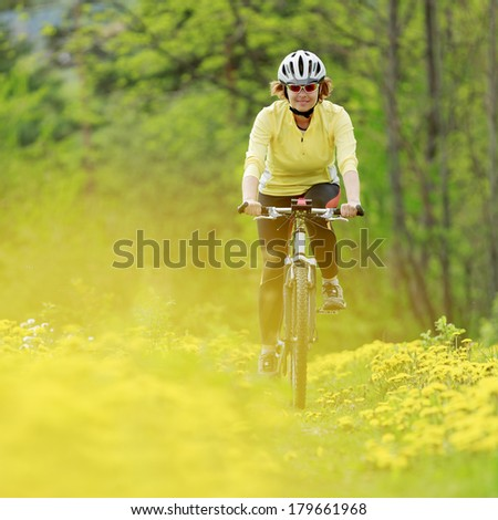 Bike riding - woman on bike - stock photo
