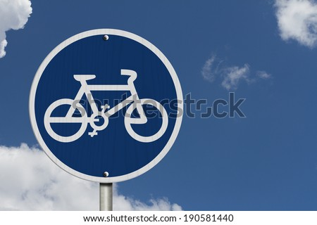 Bike Route Sign, An  blue road sign with bike icon with blue sky background - stock photo