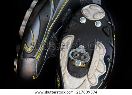 bike shoes with SPD clipless bicycle pedals close up - stock photo