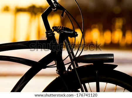bike silhouette on the beach