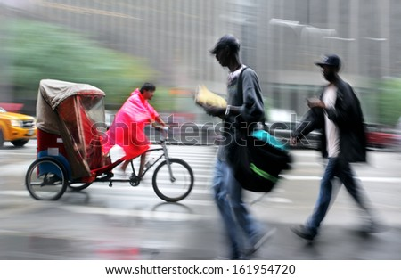 bike taxi rushing on the street in intentional motion blur  - stock photo