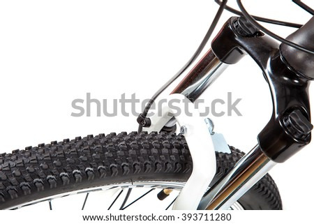 Bike wheel isolated on white background. - stock photo
