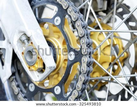 Bike wheel with chain detail. - stock photo