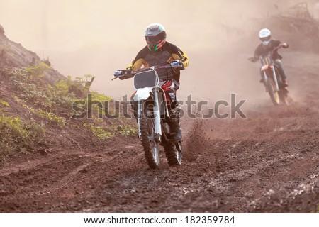 Biker biker making a stunt driver. - stock photo