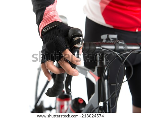 Biker checking or testing on bike brake, isolated on white background. - stock photo
