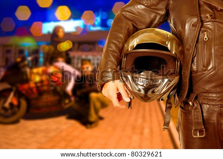 Biker closeup at night city background - stock photo