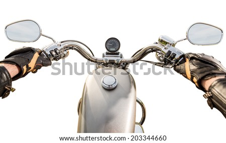 Biker driving a motorcycle isolated on white background. First-person view. - stock photo