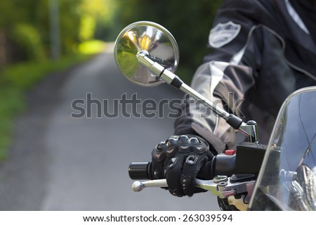 Biker fingers on the brake - stock photo