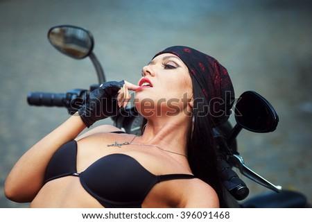 biker girl motorcycle in the city - stock photo