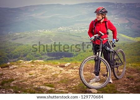 biker girl on top - stock photo