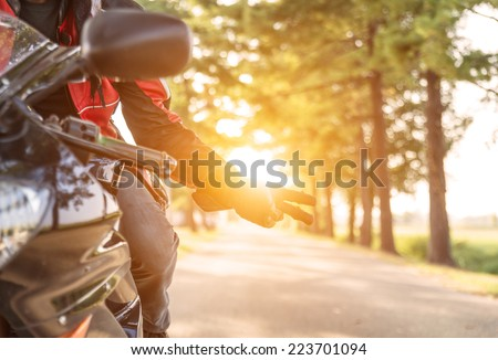 biker greeting. typical sign for greeting other bikers - stock photo
