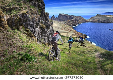 biker group on a trail in the mountains - stock photo