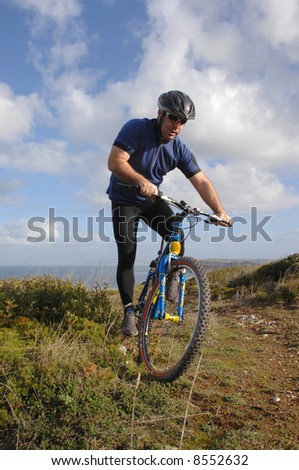 biker in action with a beautiful landscape