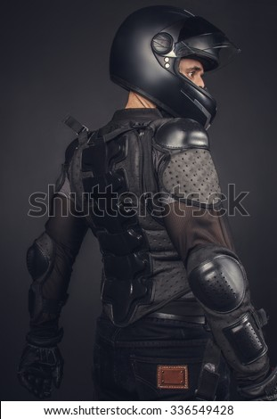 Biker in helmet and protection on his back. - stock photo