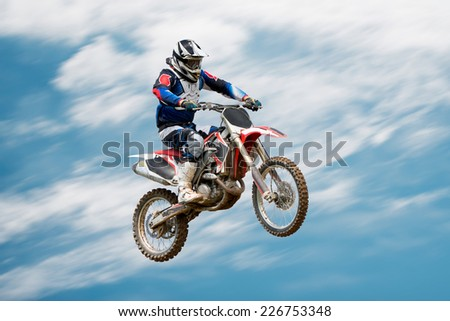 biker making stunt and jumps in the air - stock photo