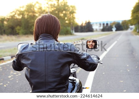 Biker man sits on bike - stock photo
