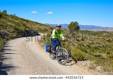 Biker MTB cycle tourism with panniers in Turia Park at pedralba of valencia
