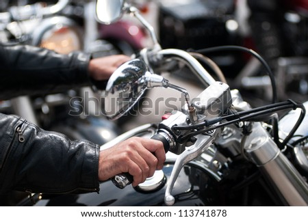Biker on chopper - stock photo
