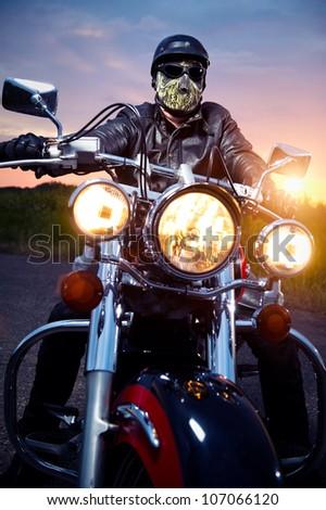Biker on the motorbike outdoors - stock photo
