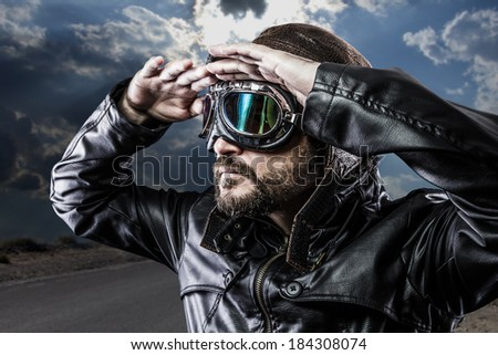 biker with black leather jacket and old glasses - stock photo