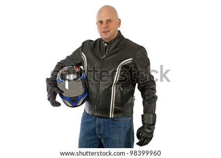 Biker with the helmet looking sharp - stock photo