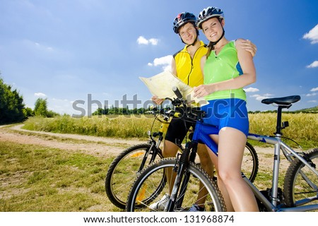 bikers holding a map - stock photo