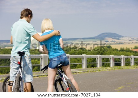 bikers holding a map, Czech Republic - stock photo