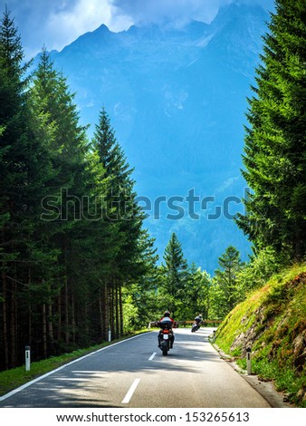 Bikers on the road in Alps, European tour, active lifestyle, driving motorcycle, enjoying freedom, summer holidays, traveling and tourism concept