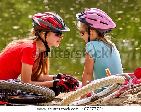Bikes cycling family. Happy mother and daughter  rides bicycle.  - stock photo