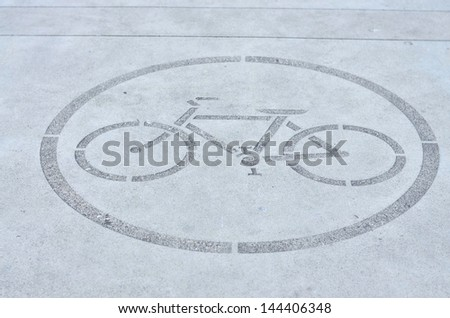 Biking allowed signage on the floor - stock photo