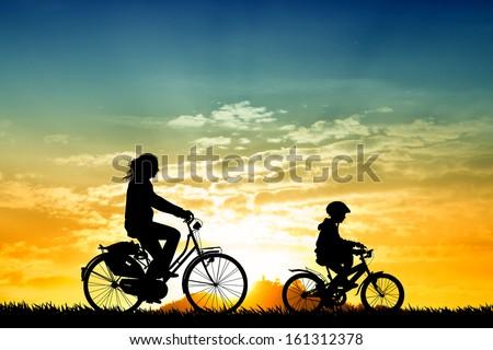 Biking at sunset - stock photo