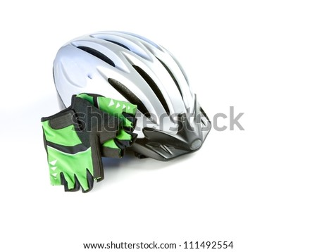 Biking helmet with riding glove, isolated - stock photo