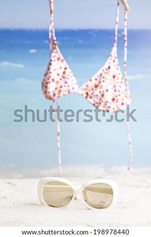 bikini and sunglasses - stock photo