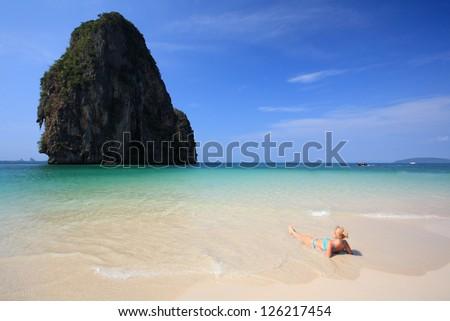 bikini female lying on beach, Krabi-Thailand - stock photo